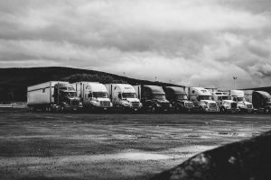 Parked Trucks Under Clouds