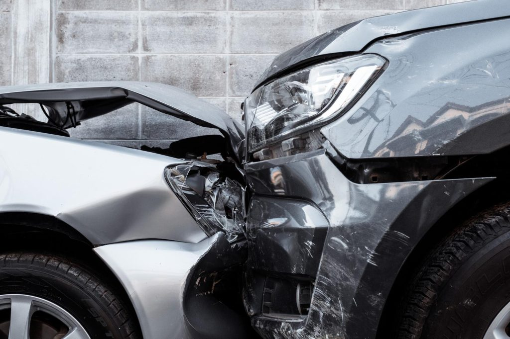 two vehicles with smashed front end after a head to head collision
