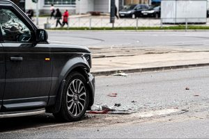 Crashed SUV on City Streets with Debris