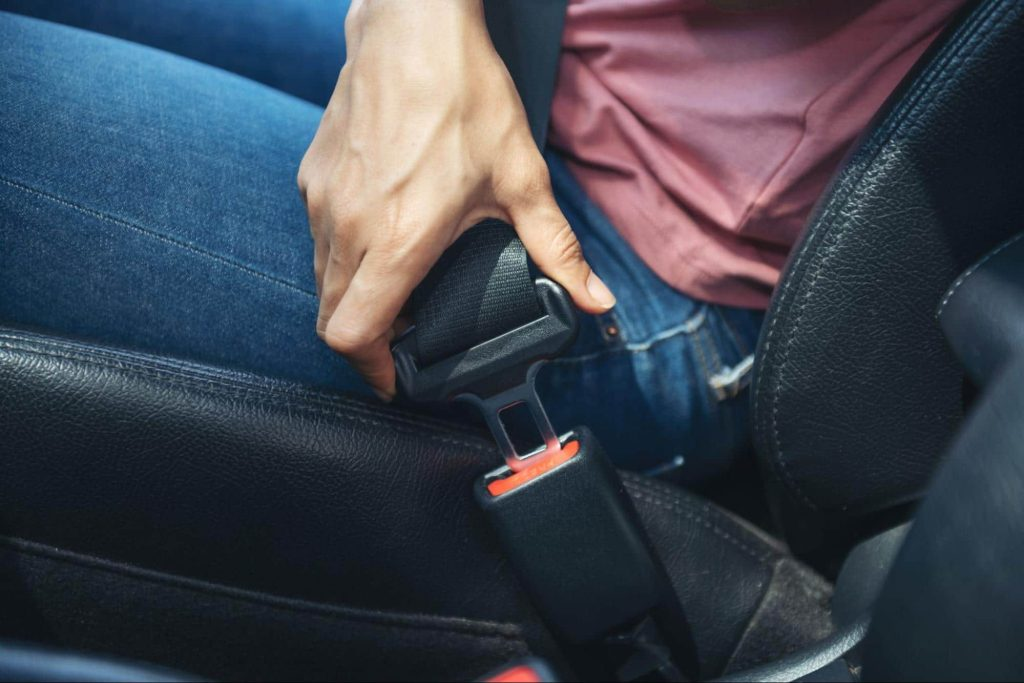 Man clicking seatbelt into place